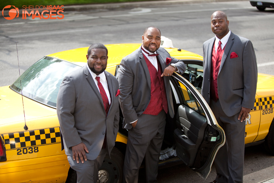 Groomsmen standing near a yellow cab