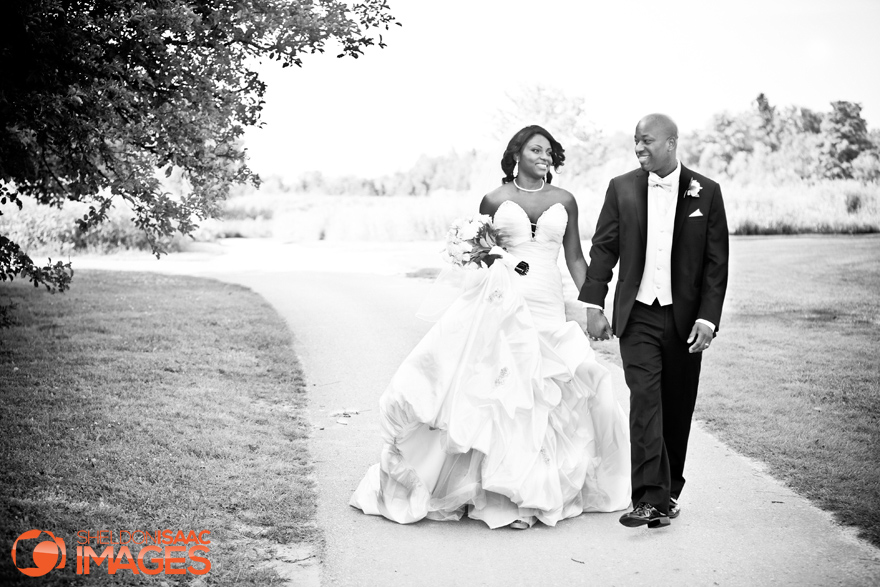 Bride-and-Groom-Walking-Deer-Creek-Golf-Club