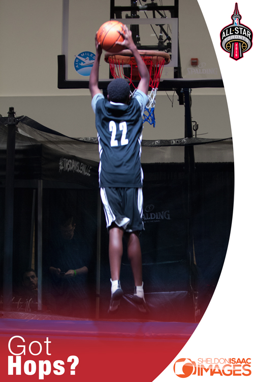 Kid dunking a basketball at NBA All Star weekend in Toronto
