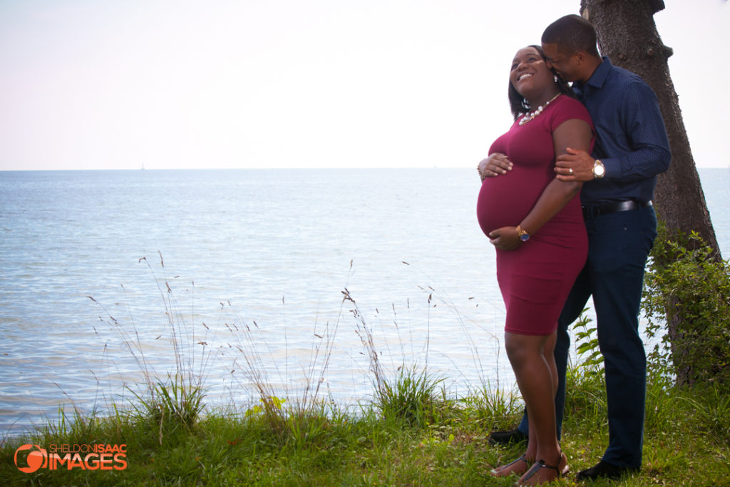 Pregnancy Photo Husband whispers to wife