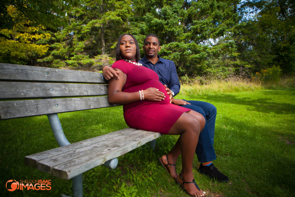 Maternity Photo Husband Wife Sitting on park bench in Ajax
