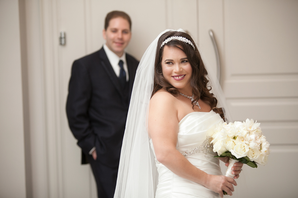Bride poses near her Groom at Hazelton Manor Banquet & Conference Centre in Vaughan