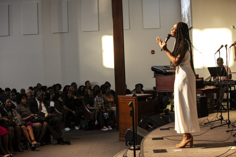 Lady singing at East Scarborough Church in Scarborough