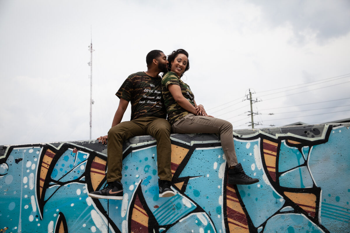 Couple sits on a skate park wall in Whitby during their Engagement photoshoot with Sheldon Isaac Images
