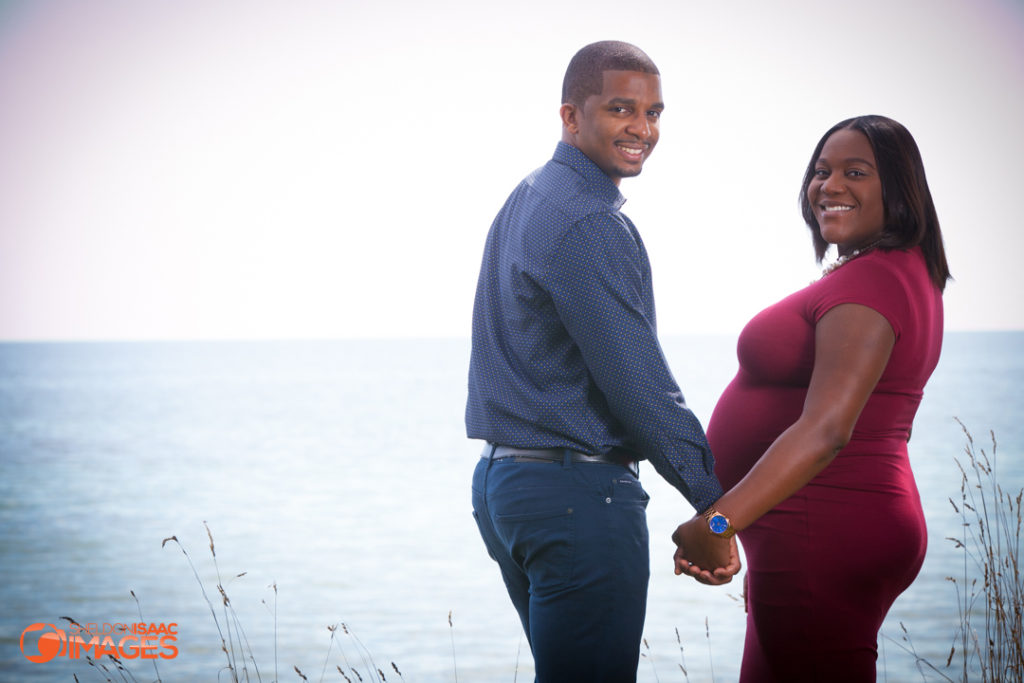 Maternity Photo couple looking at camera