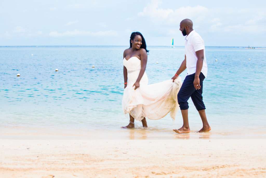 Bride and Groom laughing during Trash the Dress photoshoot in Montego Bay Jamaica