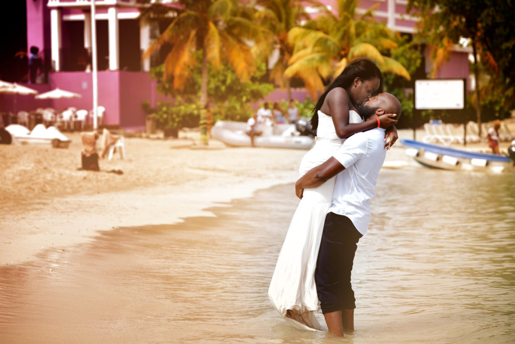 Bride and Groom kiss on the beach during Trash the dress in Montego Bay Jamaica