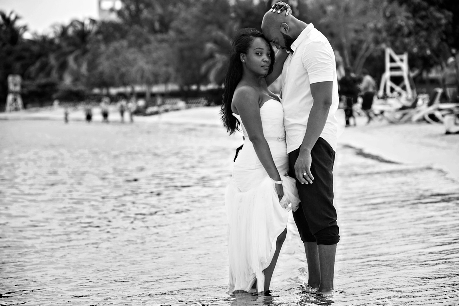 Couple hugging on the beach in Jamaica during their Trash the Dress session