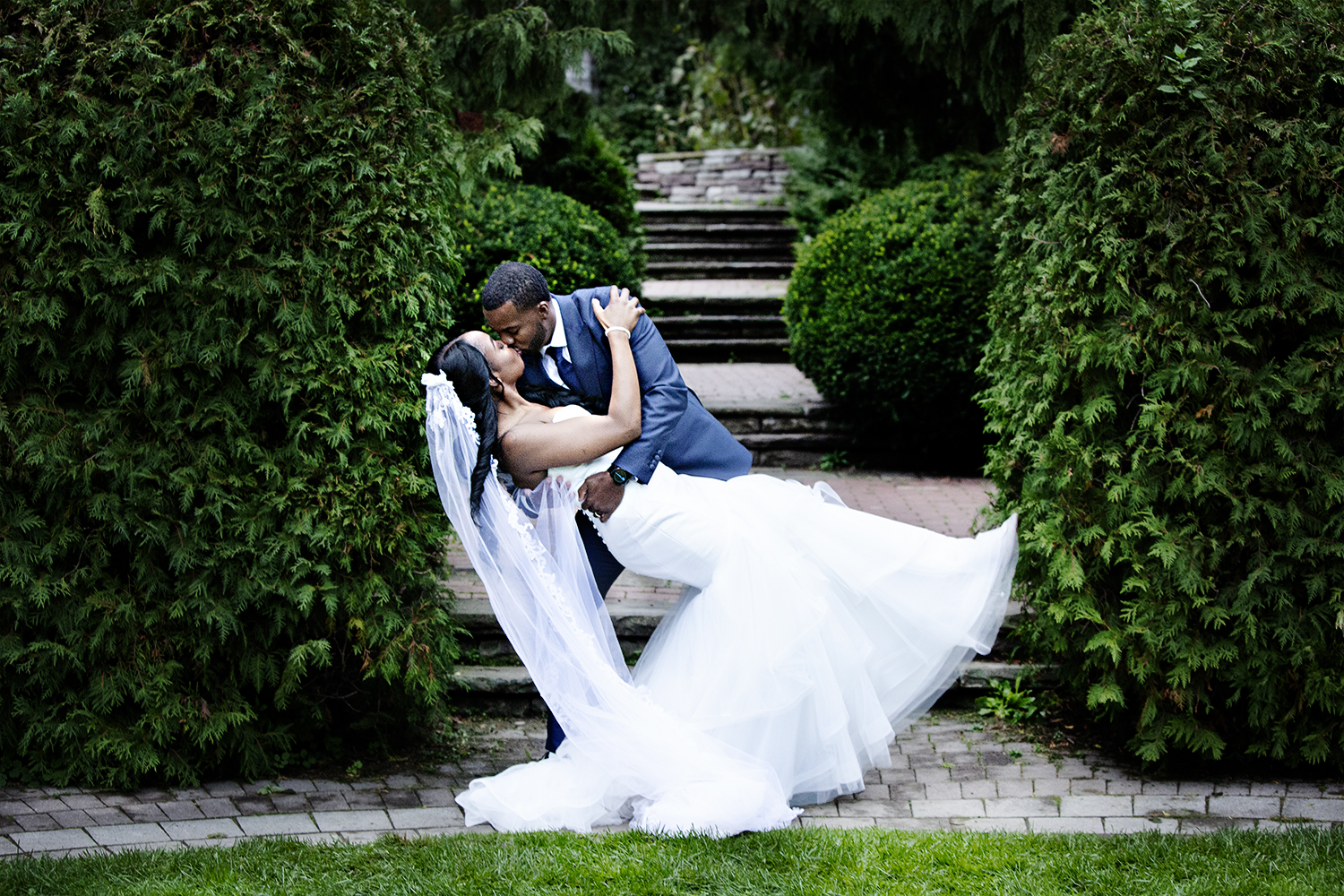 The Groom kisses his Bride during Bridal Party photos at Alexander Muir Gardens